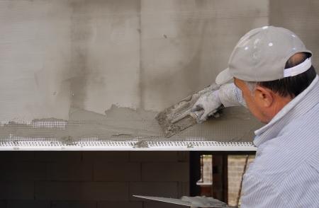 Construction site - Installing external insulation Facade therm Standard-Bild