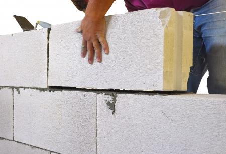 Mason performs an internal masonry blocks aerated concrete