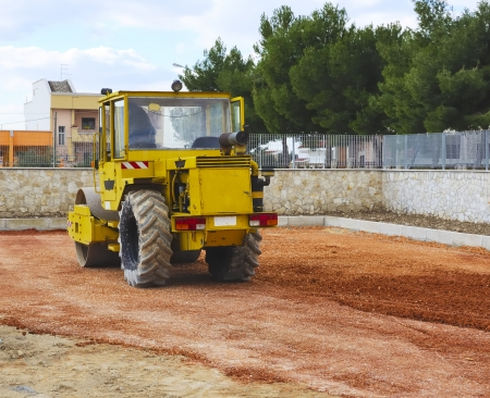 Construction site - road roller compact foundation photo
