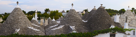 Panorama of Alberobello, Apulia  Italy   Trulli houses, dry-stone houses with conical roofs  photo