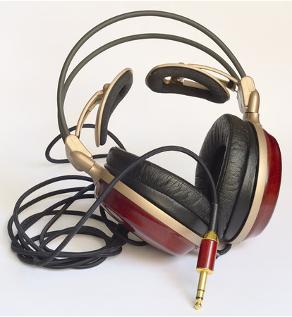 elegant wooden headphone with bearings made of soft leather and gold-plated plug Stock fotó