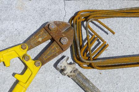 costruction: costruction equipment: scissor hammer shaped iron brackets  Stock Photo
