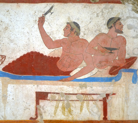 fresco: Detail ancient Greek Fresco in Paestum, Italy, called the Tomb of the Diver depicting men during a banquet.