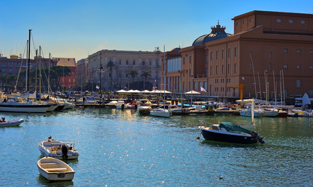 embankment: Margherita Theatre on the little port with the tipical apulian fishing boats. Bari Italy