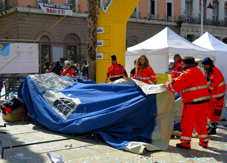 dismantled: BARI, ITALY - March 8, 2015: Volunteers of the Civil Protection dismantled a tent during the Deejay Ten Bari organized by Linus and Radio Deejay.