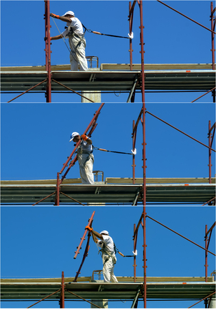 steeplejack: Safety at work. Sequence worker assembles a scaffold Stock Photo