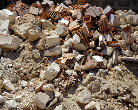 demolish: A pile of dirt and busted-up rubble at a construction site.