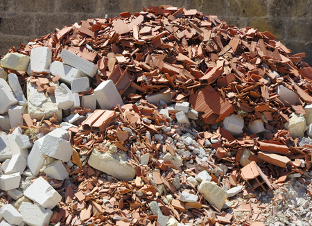 dirt pile: A pile of dirt and busted-up rubble at a construction site.