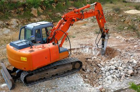 presslufthammer: Gro�e hydraulische Jackhammer Smashing Rocks