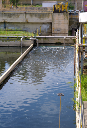 sludge: Aerated activated sludge tank at a wastewater treatment plant. Stock Photo
