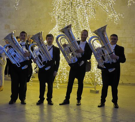 conversano: Conversano, Italy - June 2, 2015: Group of orchestral Posing With Their wind instruments tuba During the cherry harvest festival is to Organised and stalls are set-up for the tasting and the sale of the famous varieties of this important local product. Editorial