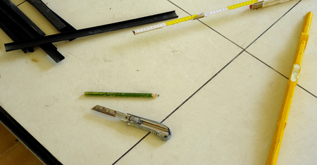 eec: level, utility knife, strips, eec. tools work for a floating floor on steel feet.