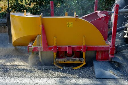 skid steer: Milling of asphalt for road reconstruction accessory for skid steer Stock Photo