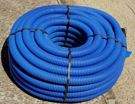 peace pipe: roll of corrugated conduit for microtrench in urban areas Stock Photo