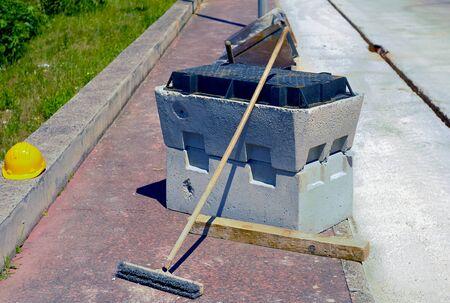 sump: pit block precast concrete, helmet and scrubbing brush