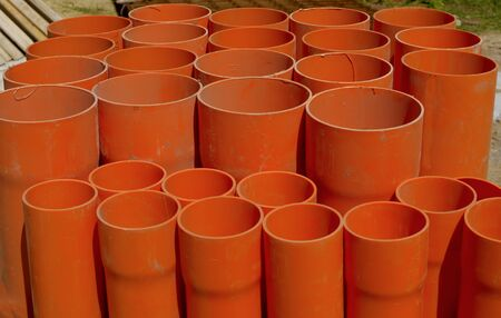 rustproof: A bundle of red pvc pipes for underground pipelines sewer