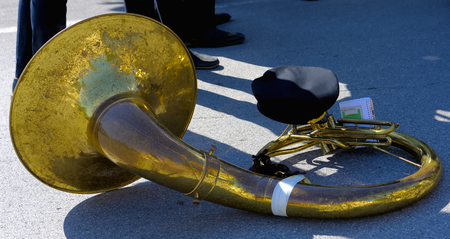 woodwind: musician nestling his woodwind musical instrument (sousaphone) during a break