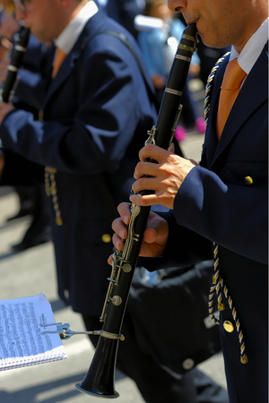 woodwind instrument: musician playing a clarinet during the patron feast Stock Photo