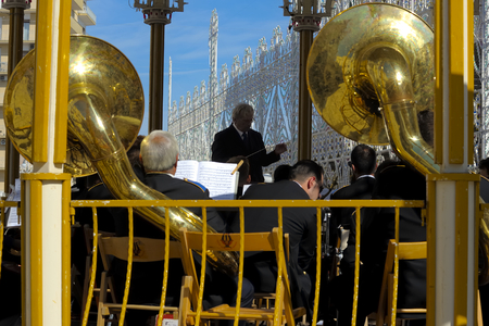 patron: Modugno, Italy - September 27, 2015 - ITALY: Conductor directs the orchestra on a sounding board During The patron feast Editorial