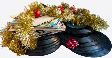 tree disc: Christmas still life with a vinyl disc and balls Christmas tree decorations on a white background. Stock Photo