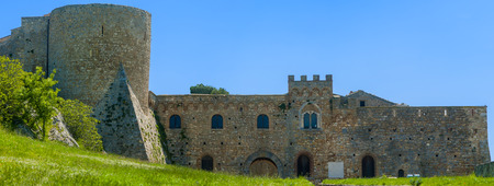 daunia: chart of the Bovino Castle, province of Foggia, seen with low angle to the level lawn in front