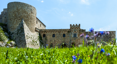 daunia: chart of the Bovino Castle, province of Foggia, seen with low angle to the level lawn in front. Southern Italy