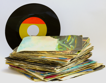 pile of 45 RPM vinyl records used and dirty even Stock Photo