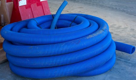 roll of corrugated conduit for microtrench in urban areas Stock Photo