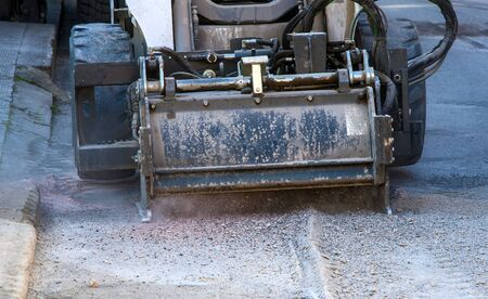 skid: Milling of asphalt for road reconstruction accessory for skid steer Stock Photo