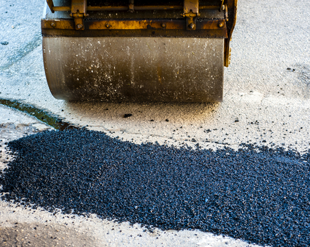 vibroroller: Heavy Vibration roller compactor at asphalt pavement works for road repairing Stock Photo