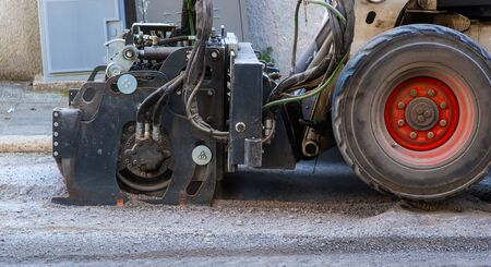Milling of asphalt for road reconstruction accessory for skid steer Stock Photo