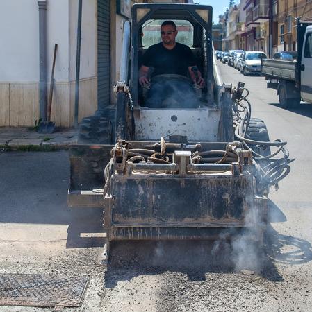 skid: worker driver Skid steer remove Worn Asphalt during repairing Road Works