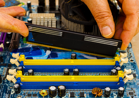 Put computer memory DDR RAM in the slot of motherboard