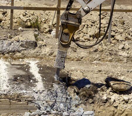 Excavator with demolition hammer in a construction site Stok Fotoğraf