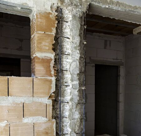 Pillar with demolition of degraded concrete for subsequent reconstruction of the reinforced concrete structure