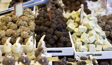 Various tasty sweets on food market. Chocolate bit sized for sale in local chocolate store. selective focus Standard-Bild