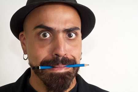 man with a pencil and a hat with funny expression with white background Stock Photo - 8086457