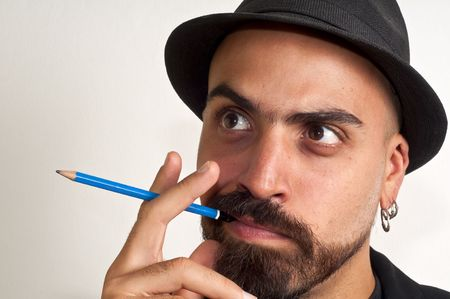 man with a pencil and a hat with funny expression with white background Stock Photo - 8086437