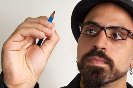 man with glasses and a hat with a pencil in white background Stock Photo - 8086456