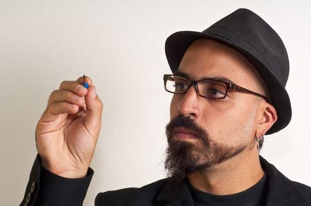 man with glasses and a hat with a pencil in white background Stock Photo - 8086455