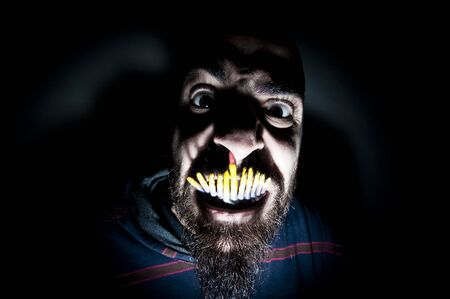 monstrous man with long teeth horror photo