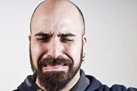 bearded man who cries on white background Stock Photo - 8966202