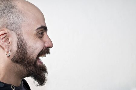 bearded man in profile that laughs on white background