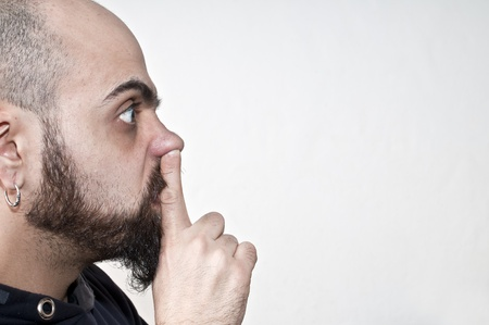 man with his finger in the nose on white background Stock Photo - 8966200