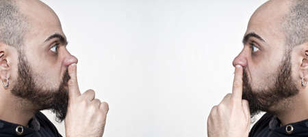 men with their fingers in their nose on white background Stock Photo - 8966215