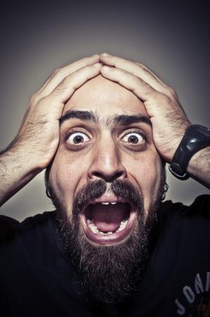 terrified man on grey background