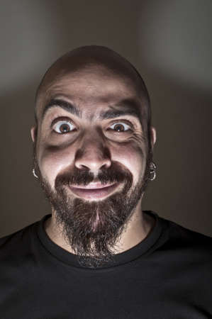 man with stupid face and dark light Stock Photo - 9791373