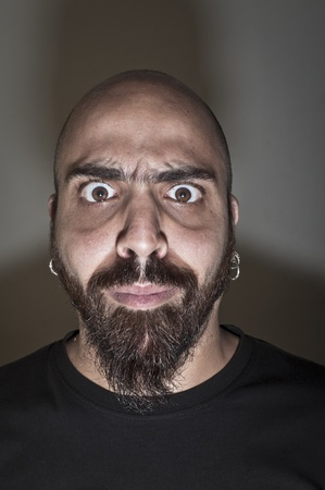 man with stupid face and dark light Stock Photo - 9791377