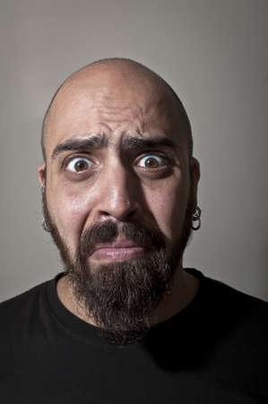 stupid body: man with stupid face and dark light Stock Photo