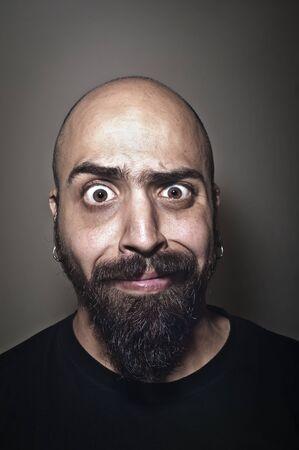 man with stupid face and dark light Zdjęcie Seryjne